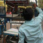 rickshaw hood cover branding in delhi-RAPIDO texi bike apps (wm)