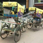 rickshaw hood cover branding in delhi-RAPIDO