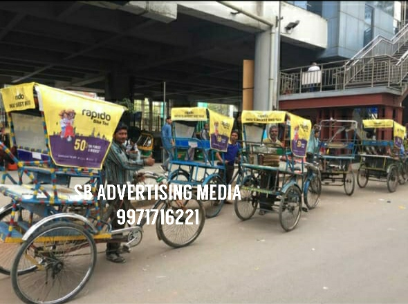 rickshaw hood cover branding in delhi (wm)-RAPIDO texi bike apps